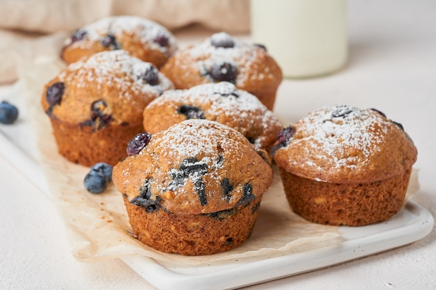 Blueberry muffin, side view, close up. cupcakes with berries on white concrete table, breakfast