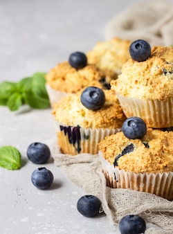 Blueberry muffins with fresh berries and mint leaves