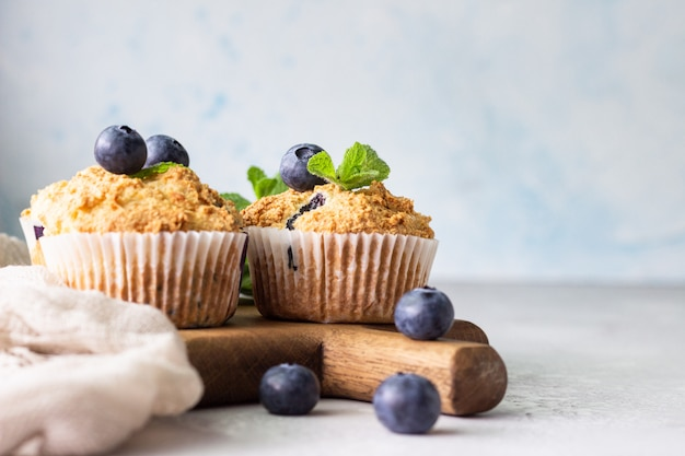 Blueberry muffins with fresh berries and mint