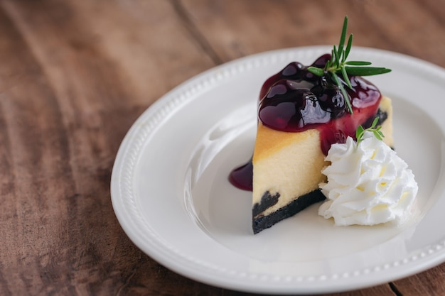 Blueberry new york cheesecake with whipped cream