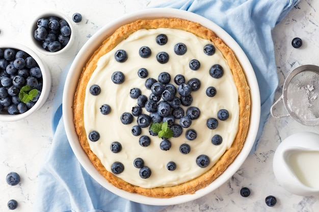 Blueberry tart with whipped cream