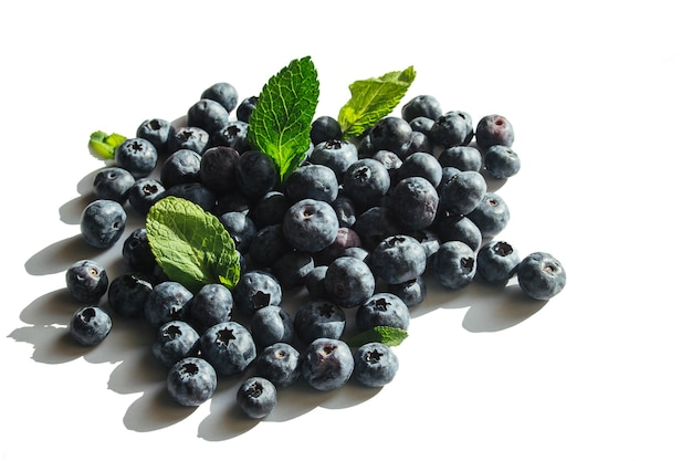 Blueberry with mint leaf isolated on white surface