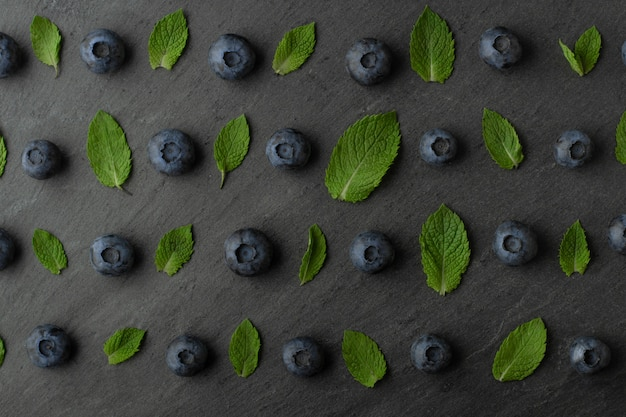 Blueberry with mint seamless pattern on concrete background