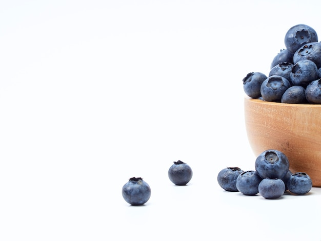 Blueberry in wooden bowl
