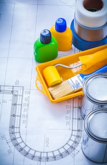 Blueprint with paint brush tray roller cans bottles and adhesive household tapes maintenance concept