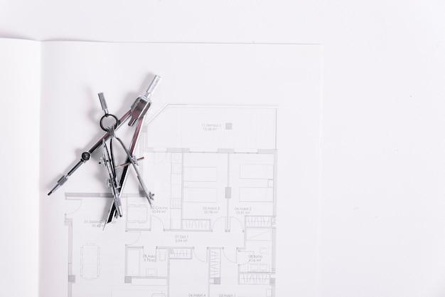 Blueprints under compasses