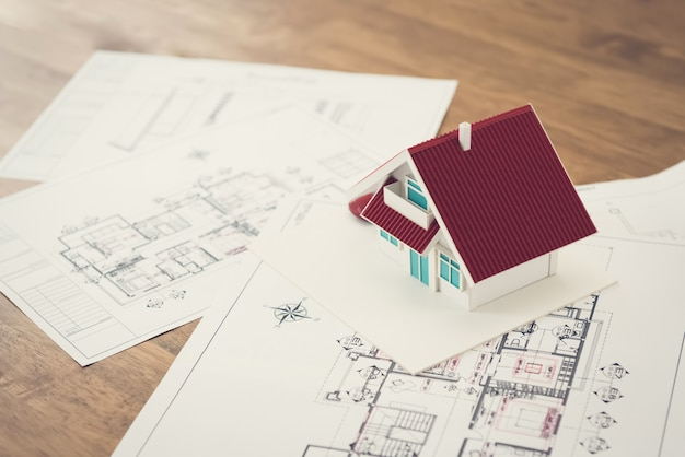 Blueprints and house model on the table