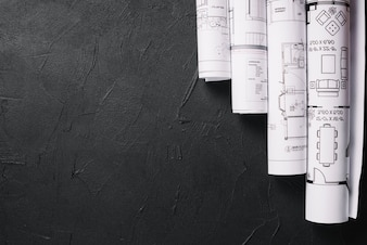 Blueprints on black table