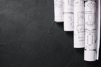 Blueprints on black table