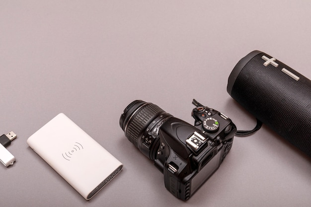 Bluetooth speaker and powerbank with dslr camera closeup. online music concept.