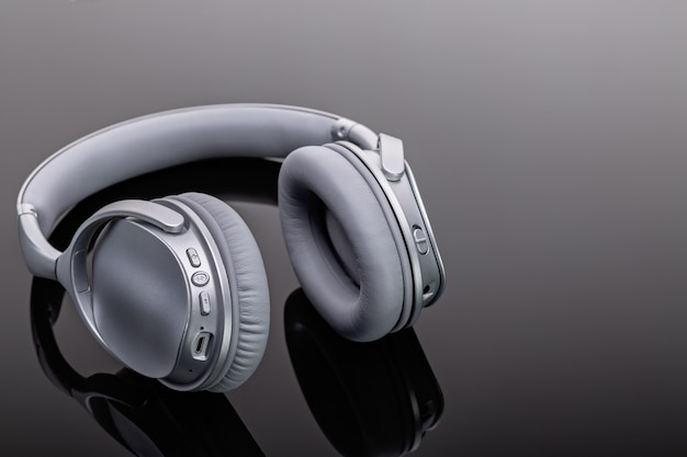 Bluetooth wireless headphones. modern devices for listening to music. studio shot, copy space.