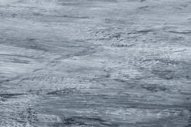 青みがかった銀の大理石の織り目加工の背景