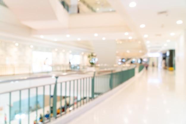 쇼핑몰의 통로 및 소매점을 흐리게 처리하십시오.