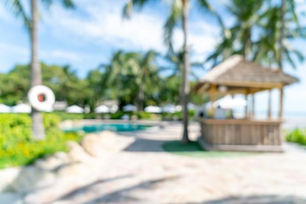 Blur bed pool around swimmimg pool in luxury hotel resort