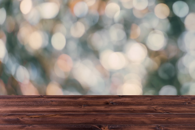 Blur bokeh with wooden table top for background, industrial dark color tone.