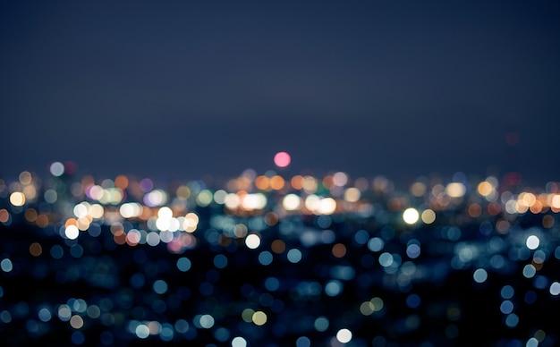 Размытие красочный боке ночной городской пейзаж фон.