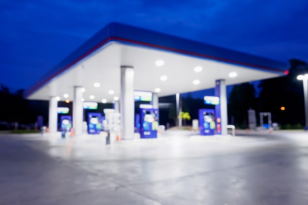 Blur gas station at night time for background