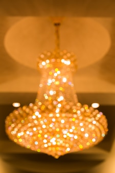 Blur image of chandelier in the hotel