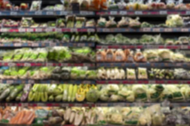 スーパーマーケット、ミニマートの新鮮な野菜と果物のセクションの背景の画像をぼかし
