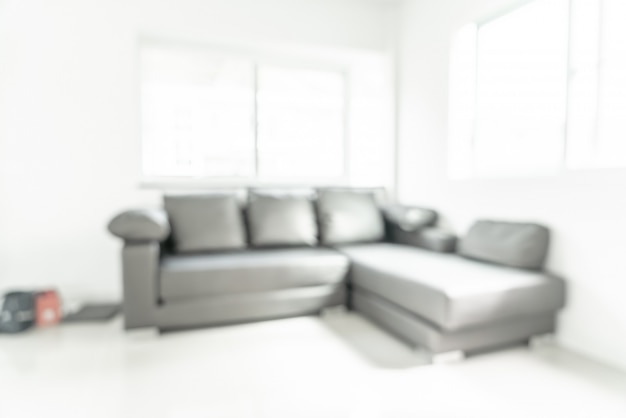 Blur image of living room with table and sofa for blurred background