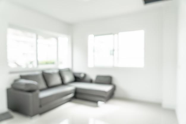 Размытие изображения гостиной со столом и диваном для фона