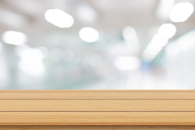 Blur inside office with modern wood table background for show ads