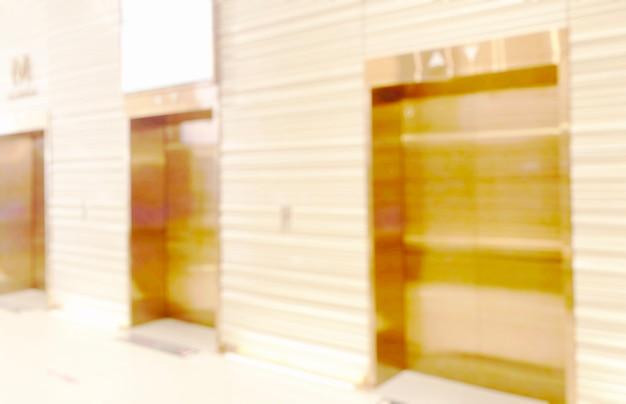 ビジネスの背景のためのモールの店で明るい背景をぼかす、内部の廊下でぼやけた抽象的なボケ味
