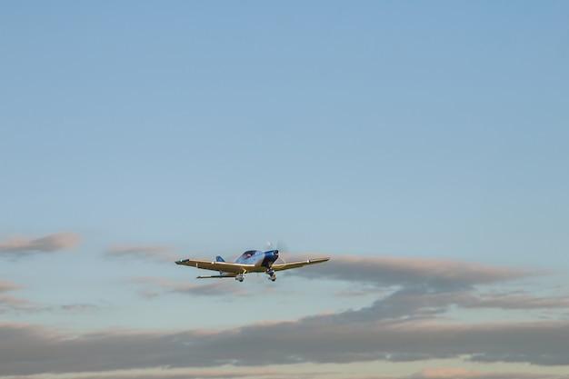 Blur light small plane against blue clouds