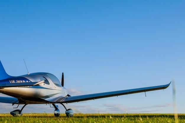 Blur light small plane on a grass field
