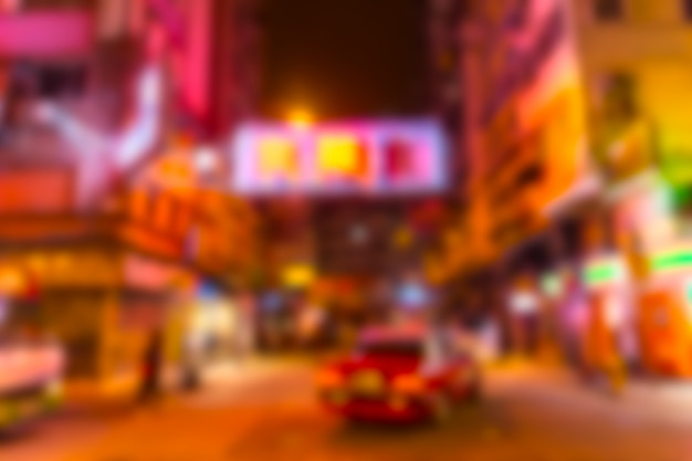Blur night china town colorful neon travel street in hong kong for background