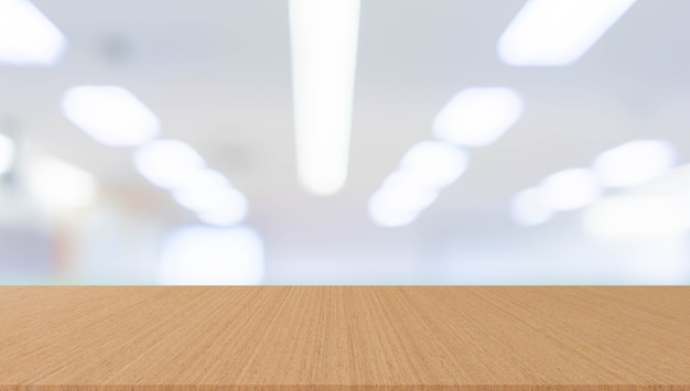 Blur office with modern wood table perspective for background design ads concept