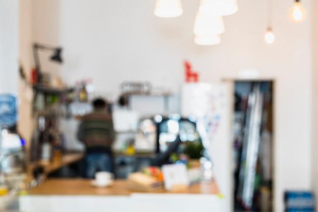 コーヒーショップやカフェテリアのぼやけや多重画像