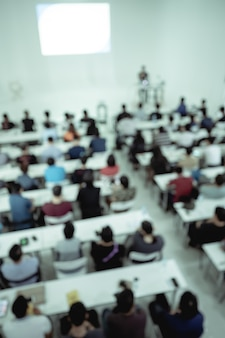 Blur of people in conference room.