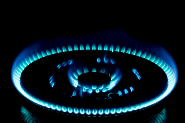Blur photography,home lpg.firing.burning gas burner in the darkness.natural energy concept.