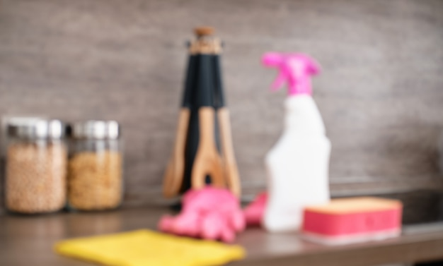 Blur picture. detergents and cleaning accessories on kitchen. cleaning and washing kitchen. cleaning service