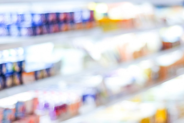 Blur product shelves in supermarket background