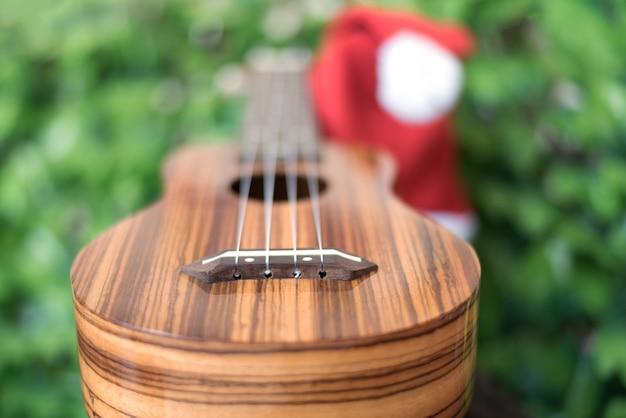 Blur ukulele with christmas hat