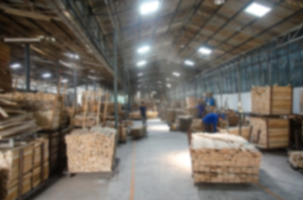 Blur working in wood factory