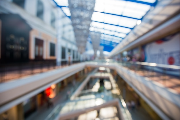 Blured big mall multi-level shopping center with bokeh background