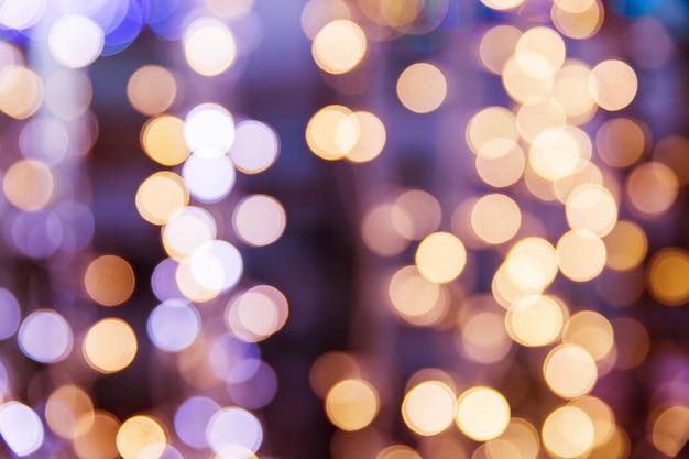 黄色の光がボケのテクスチャ。クリスマスライトblured
