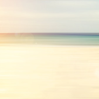 Blurred abstract background of beach with light bokeh - vintage color styles