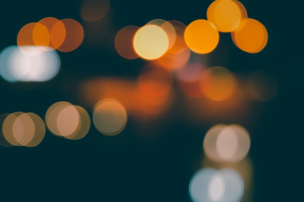 Blurred abstract background of city street lights bokeh illuminated at night
