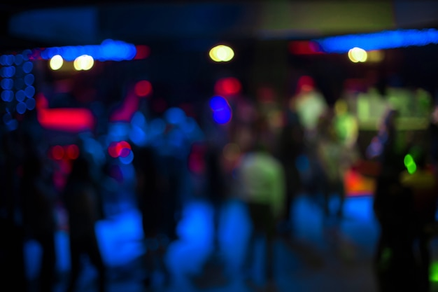 Blurred abstract image of people dancing in a nightclub.
