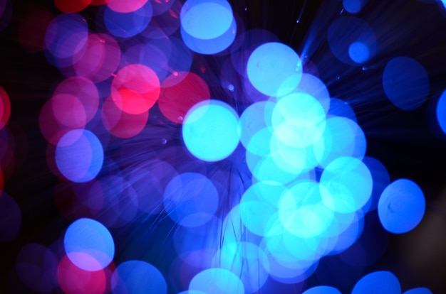 Blurred abstract pink and blue bokeh lights.