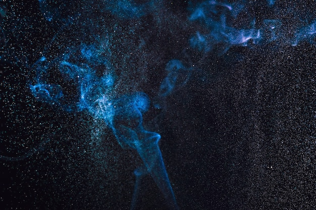 Blurred abstract smoke and spray of water on a black background