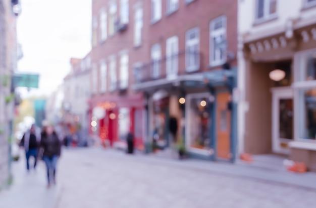Размытые абстрактные виды улиц зданий и магазинов в центре города с фоном огней боке