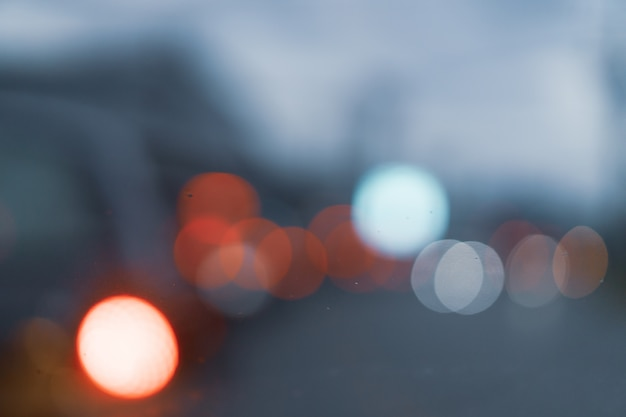 Blurred abstract of traffic on street in city through front car window