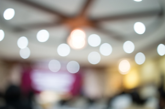 Blurred of audience listening speaker speech in conference hall or seminar room