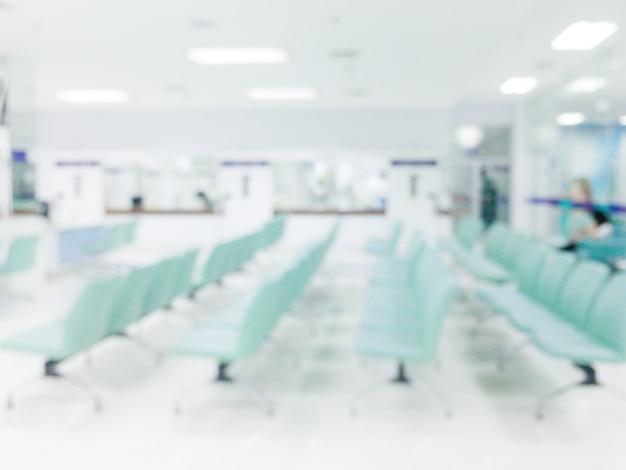 배경을 흐리게-배경에 대 한 추상 흐림 아름다운 고급 병원과 클리닉 인테리어. 빈티지 효과 스타일 사진.