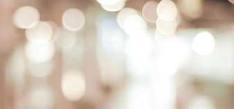 Blurred background, brown festive light abstract bokeh background, banner